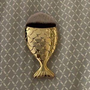 Gold mermaid tail makeup brush